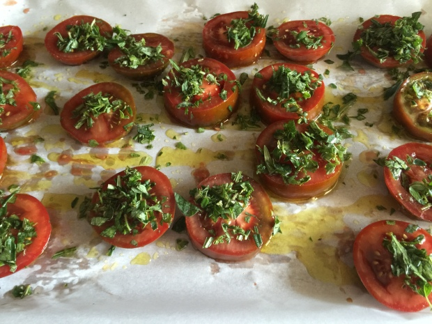 Sliced fresh tomatoes with salt, pepper, herbs, olive oil
