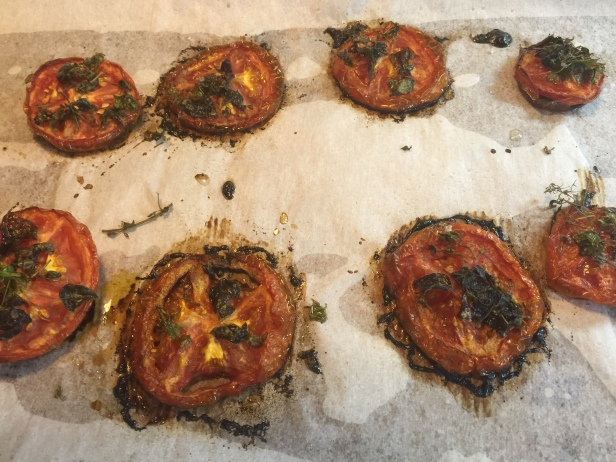 tomatoes that have been backed and out of the oven