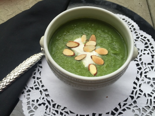 Healthy Broccoli Soup Garnished with Sour Cream and Almonds