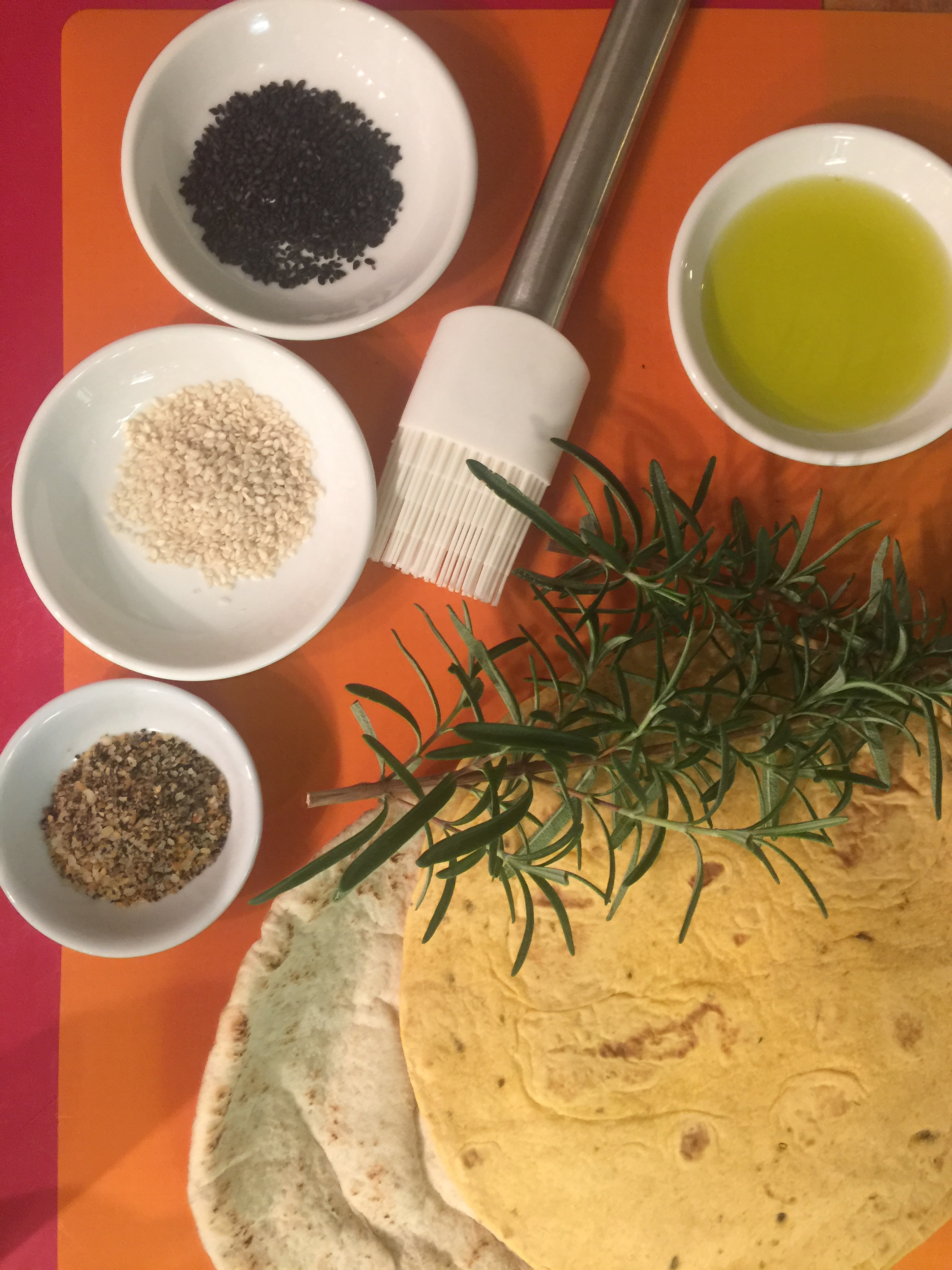 Tortillas, pita bread, black and white sesame seeds, steak seasoning, olive oil